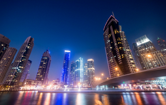 invest in dubai real estate business bay at night